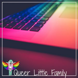 A rainbow spectrum of light over a laptop keyboard.