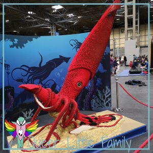 A giant squid attacking another squid - all made of lego.