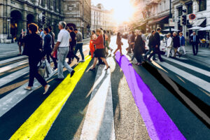 people crossing a road - the crossing has been coloured digitally in the nonbinary pride flag colours - yellow, white, purple and black